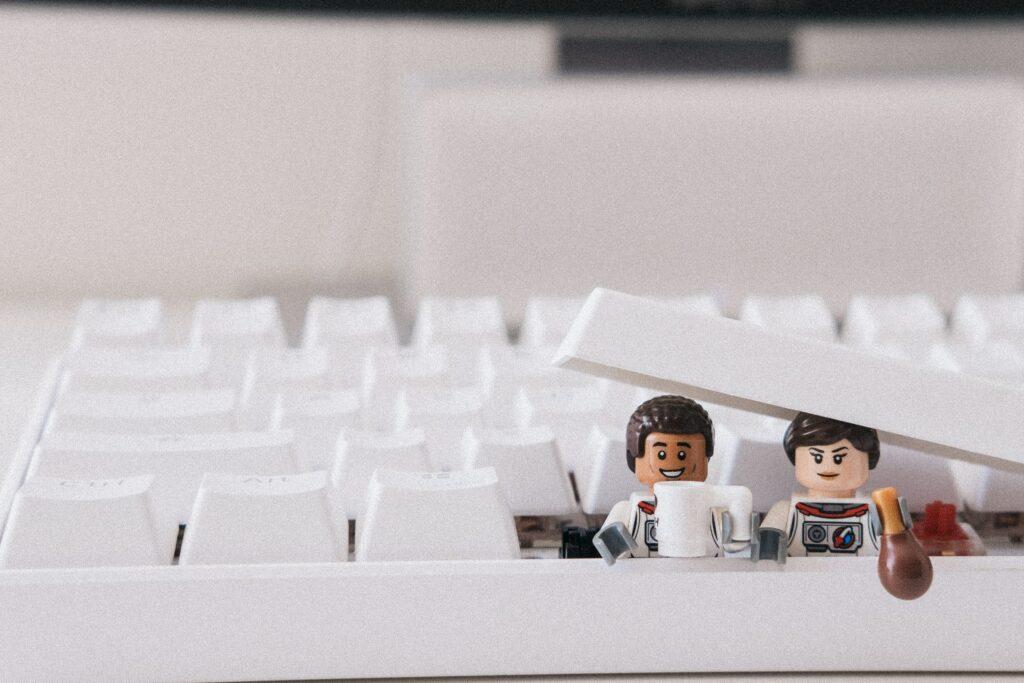 white computer keyboard on white surface